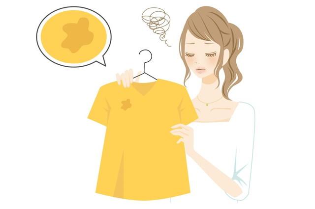 服の汚れにショックを受ける女性のイラスト