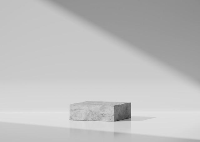 白い背景の上の3Dコンクリート台座表彰台