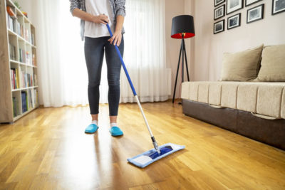 Wiping a floor with a floor wiper