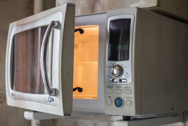 modern microwave oven installed in the kitchen