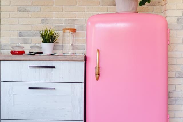 Retro style pink fridge in vintage kitchen