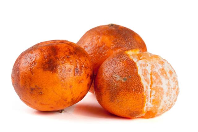three damaged tangerine isolated on white background