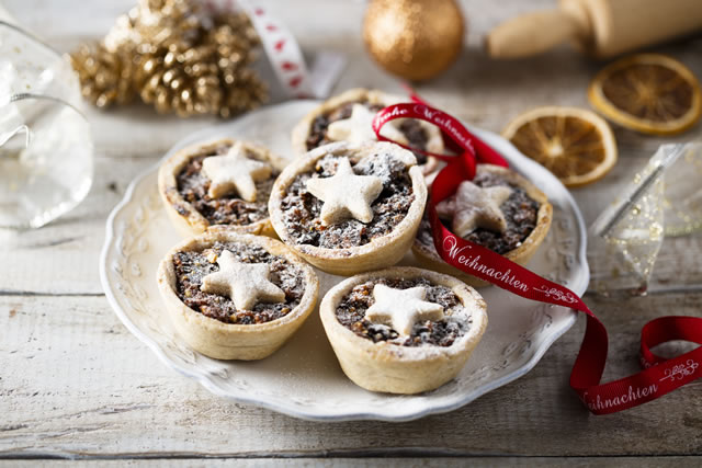 Homemade festive mince pies on white plate