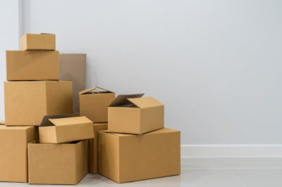Stack of cardboard boxes in empty room
