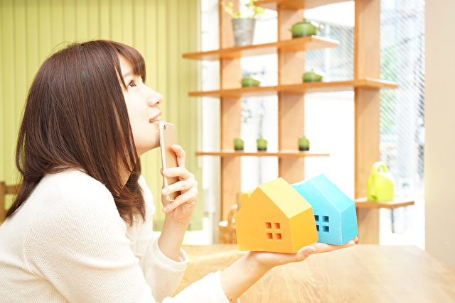 Young woman choosing house and real estate
