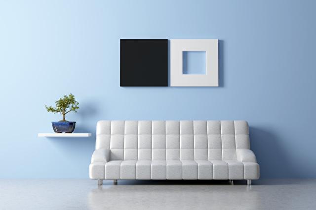 水色の壁と白いソファー
