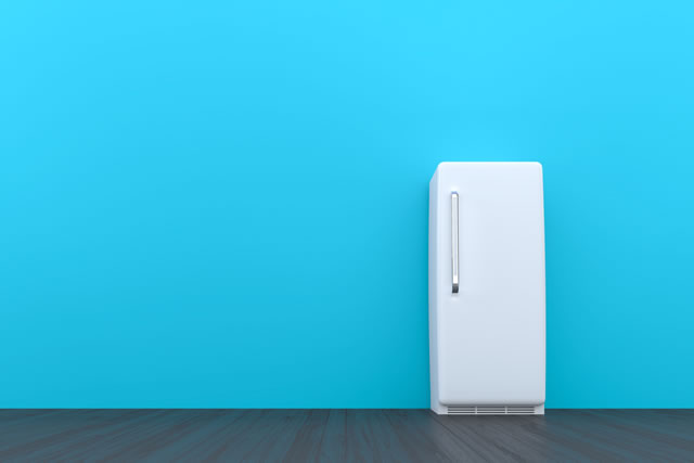White retro fridge in an empty room with a blue wall and black wooden floor - 3d illustration