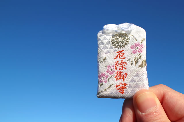 Japanese protective charm in the blue sky