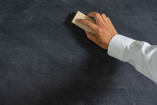 Hand holding brush eraser and blackboard , Concept education and school