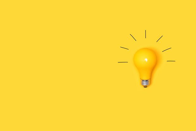 Idea light bulb on a vivid yellow background