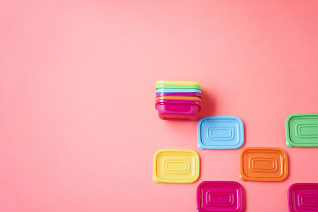 plastic container and pink background