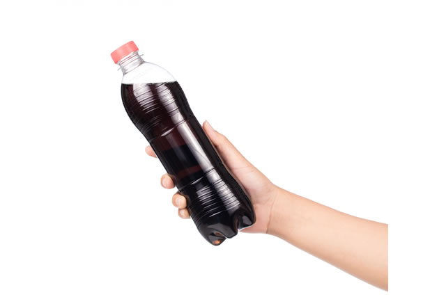 Hand holding cola plastic bottle is a carbonated soft drink isolated on white background