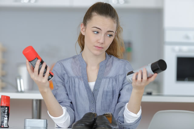 young woman cleaning her shoes