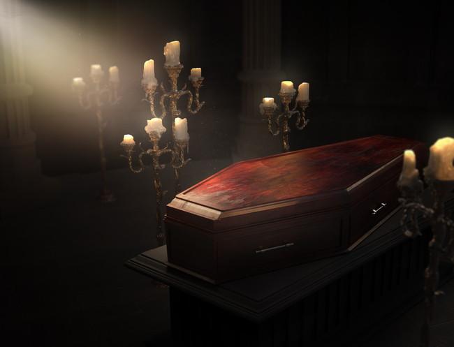 西洋型の棺とキャンドル