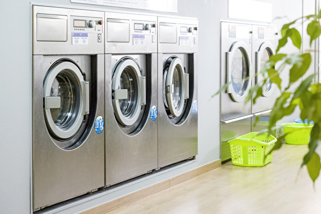 Public laundry with modern, silver washing machines