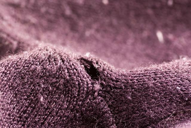 Hole on the purple sweater