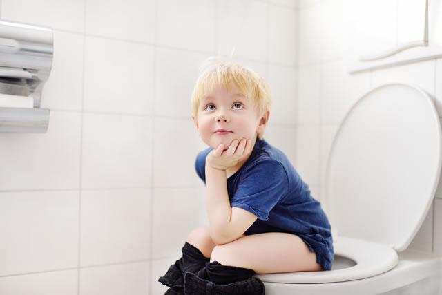 Cute little boy in restroom