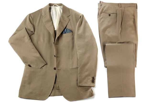 Beige suit with neatly folded pants and jacket