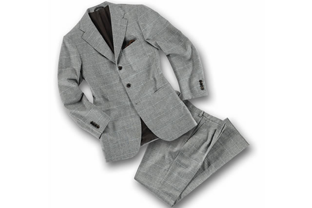 Elegant grey tailored suit on white