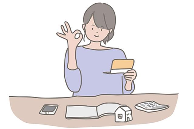 家計簿をつける若い女性